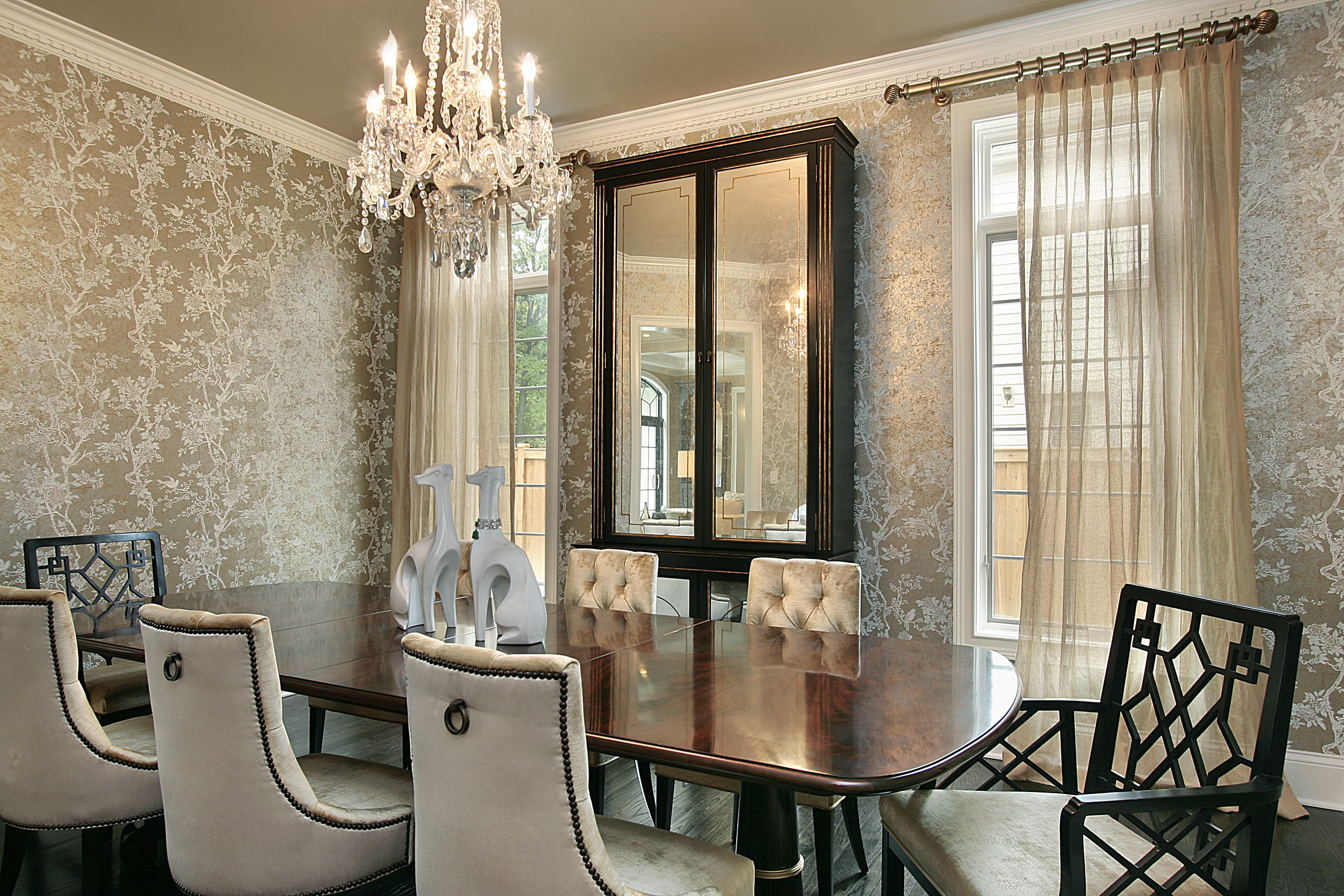 Dining room in luxury home with gold walls
